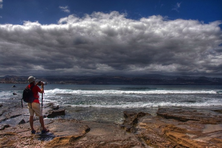 photographer capturing the ocean